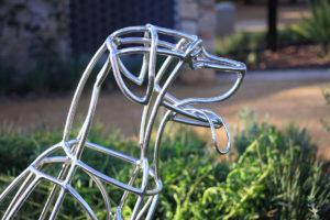 Therapeutic landscape design metal dog sculpture