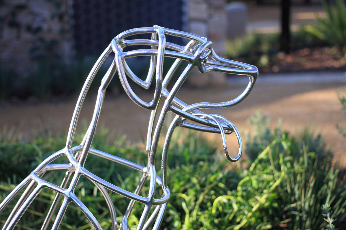 Therapeutic landscape design metal dog sculpture