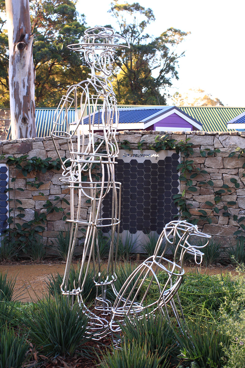 Therapeutic landscape design man and dog sculpture