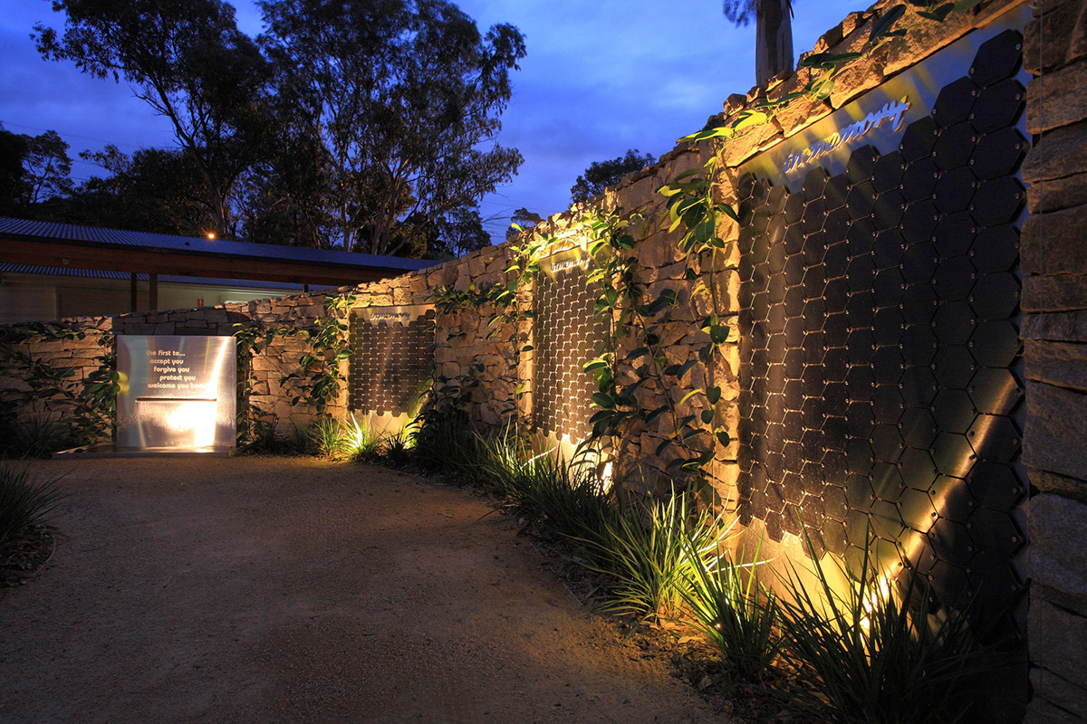 Therapeutic landscape design memorial wall at night