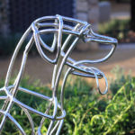 Wire dog sculpture landscape architecture