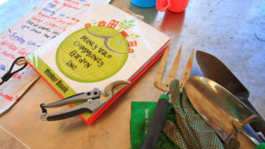 Manly Vale Community Garden visitor book and garden tools
