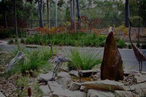 Image of rock garden with bird sculptures