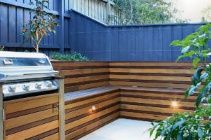 Built in bespoke timber bench seat and BBQ to make the most of the space