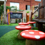 Play space design blackboard and toadstool seats