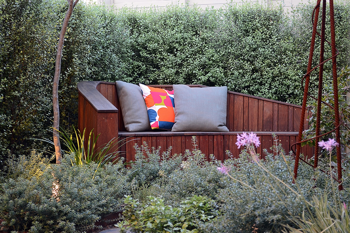 The seat becomes a little sanctuary in the garden