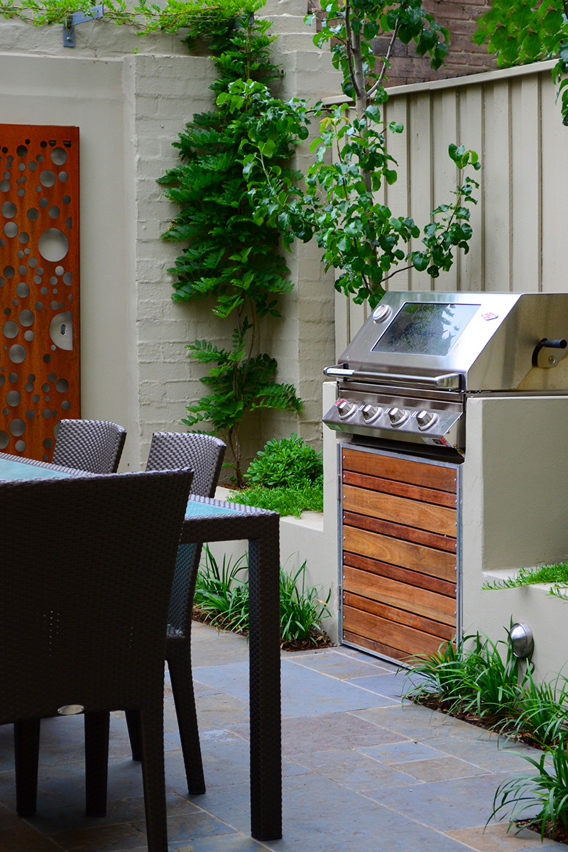 Backyard landscape design bbq area