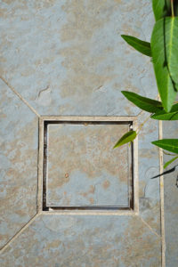 Courtyard landscape design drain integration