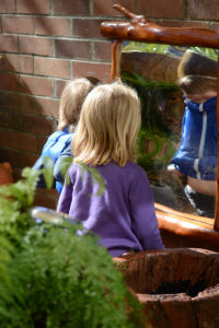 Children interacting with timber play elements
