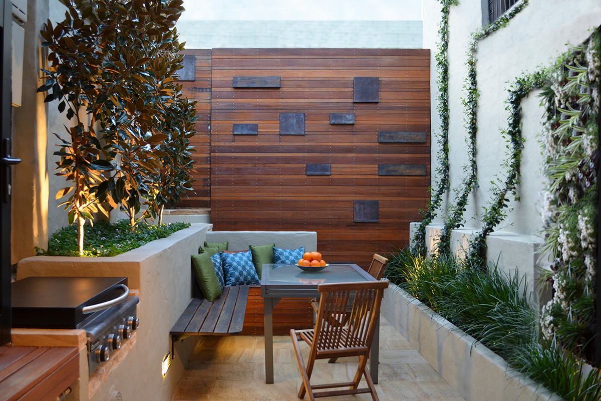 Courtyard landscape design with seating and bbq