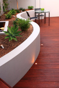 Curved wall and decking landscape design