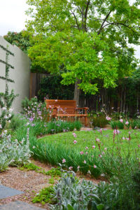 Backyard landscape design garden bench