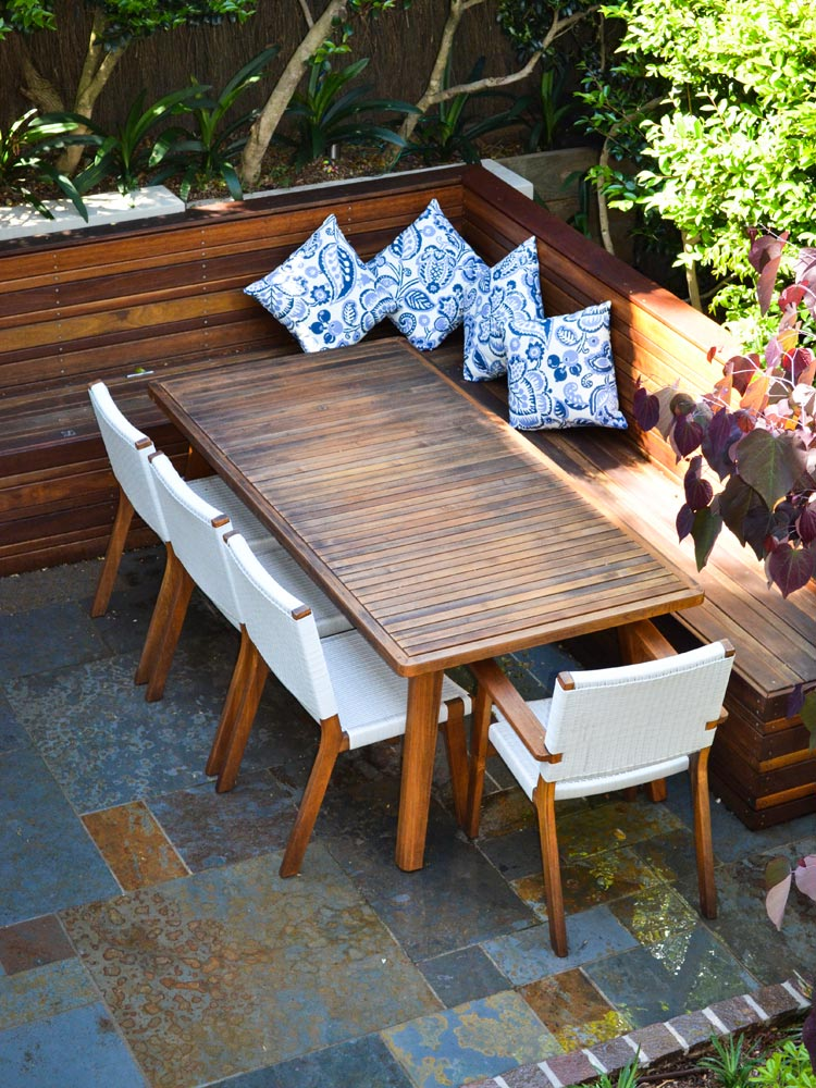 Outdoor dining with built in timber seat and cushions