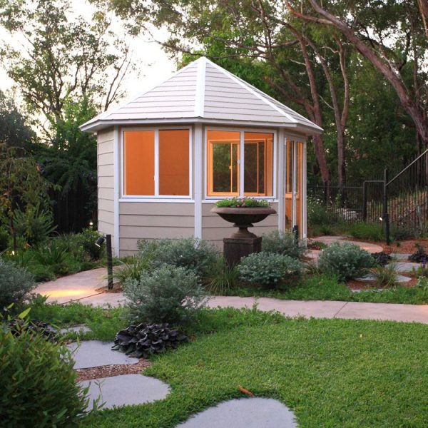 Summer house nestled into a native garden