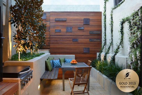 Tiny courtyard with feature wall, climbers and functional family space