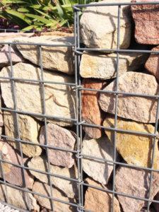 Backyard landscape design gabion wall feature