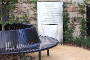 RSPCA Memorial garden with round seat, lush planting and water feature