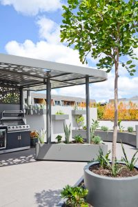 Gorgeous overhead structure's style matching with the wall pots