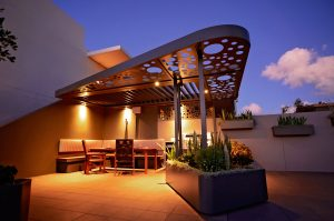 Overhead vergola takes a whole new feel when lit up at night