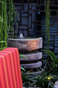 Detail image of water feature and surrounding plantings