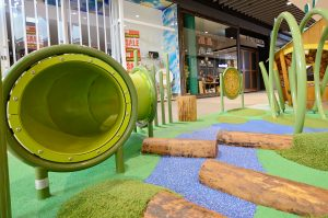 A crawl tunnel and balance logs teach children balance and movement through a space