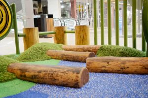 Log steppers help kids learn to balance and create an interesting ground plane to play on