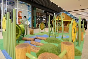 The varied levels in the play space help create exploration and challenges for younger children