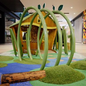 Play tunnel structure and grass mounds