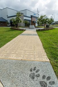 Engraved brick pathway to water feature