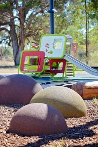 Climbing mounds combined with natural play