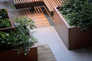 Close up image of corten steel planter boxes and overhanging plantings