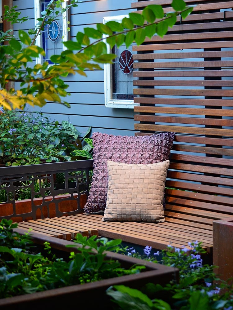 The outdoor bespoke timber lounge within the courtyard.