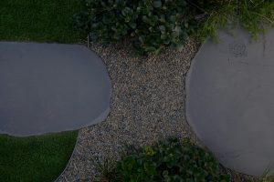 Close up of turf and gravel path finishes with large blue stone steppers