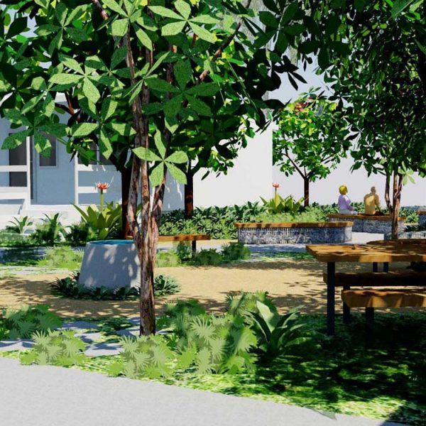 A visual perspective of the peaceful garden with seating among a shaded canopy for staff and clients