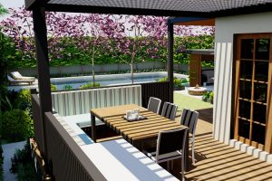 View of back garden from outdoor family BBQ and dining area shaded by adjustable Vergola overhead system