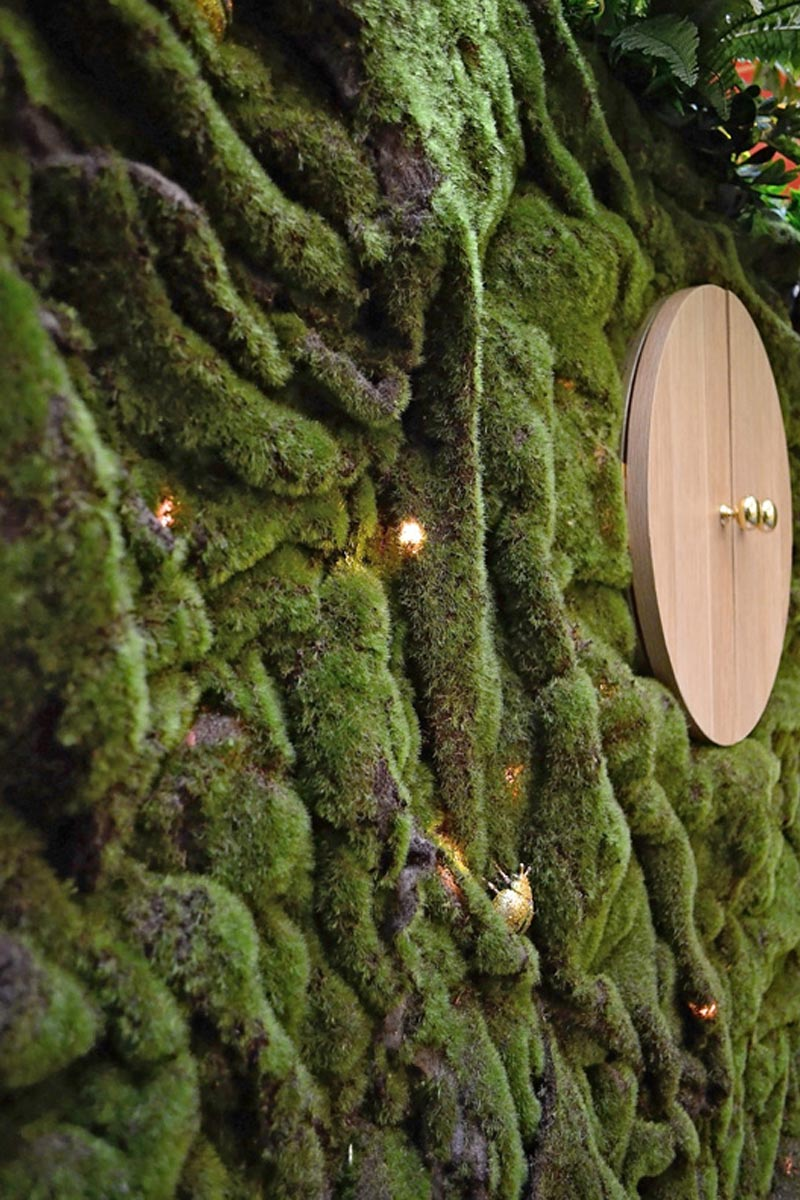Green moss wall with Christmas beetles